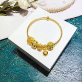 Solid gold charm bracelet with 5 pcs charms