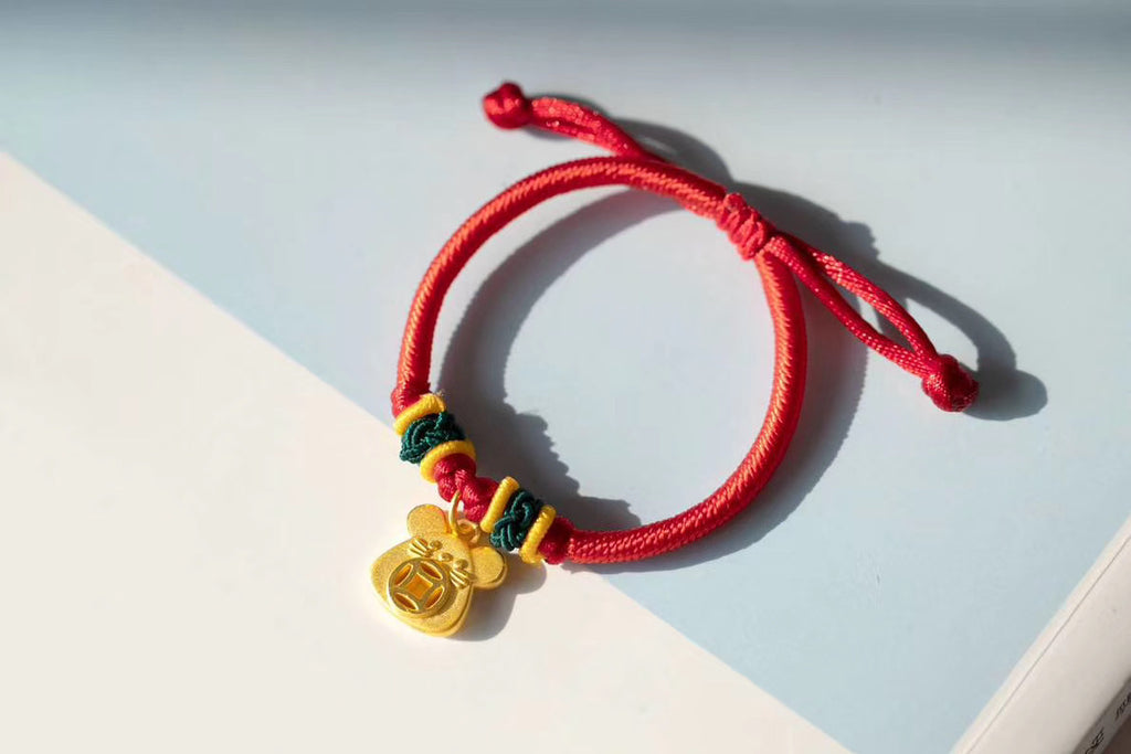 Solid gold mouse red rope charm bracelet