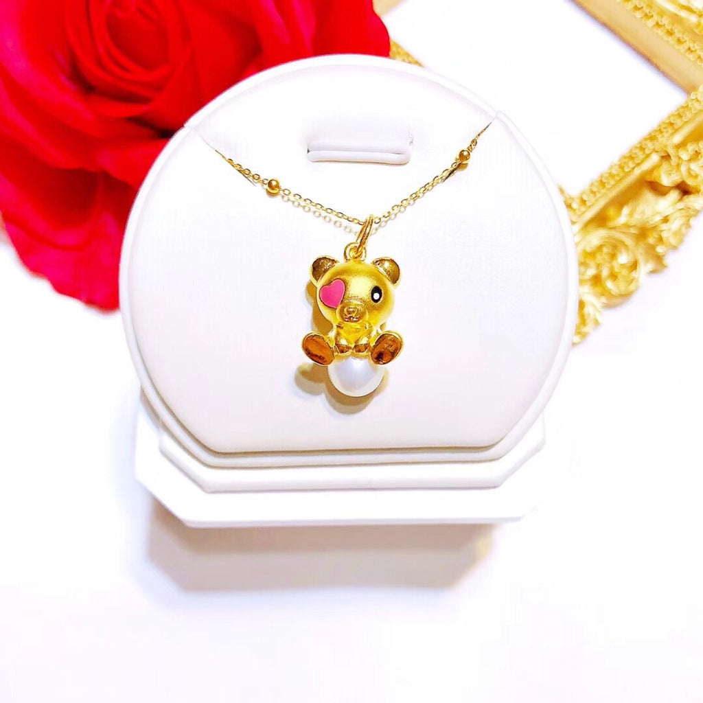 Solid gold bear charm necklace