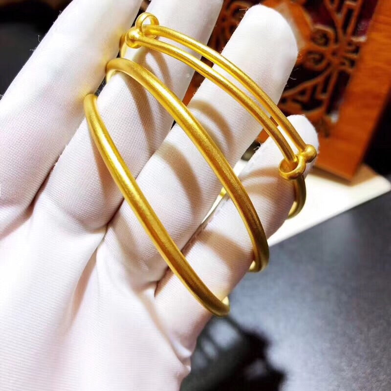 Solid gold push bangle bracelet