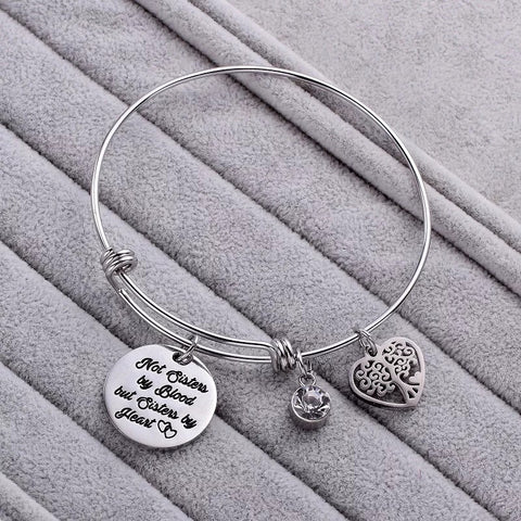 Push bangle bracelet with listen to your heart pendant