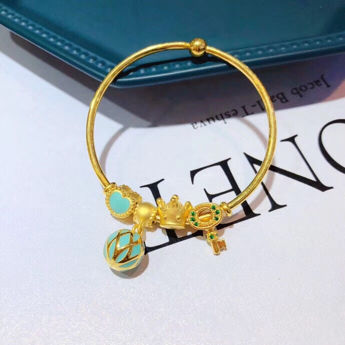 Solid gold charm bracelet with Swarovski crystal