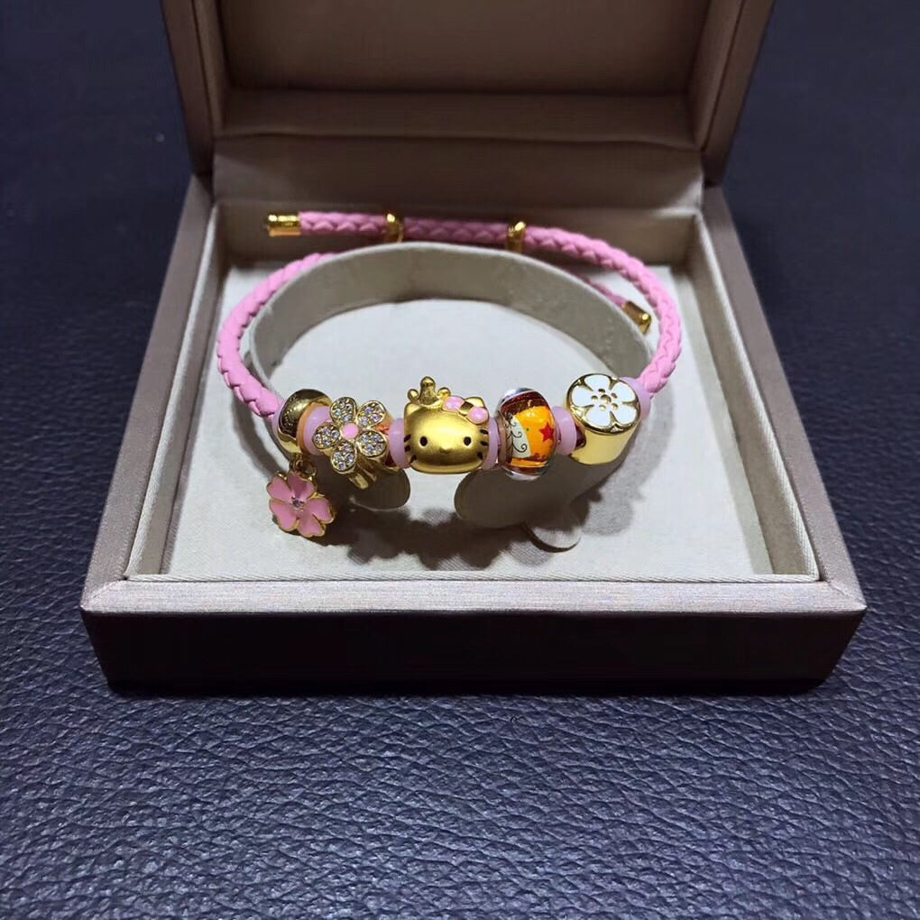 Solid gold hello kitty pink leather charm bracelet