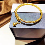 Solid  gold open bangle bracelet with gourd pendant