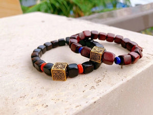 Solid gold charm bracelet ebony wood beaded bracelet