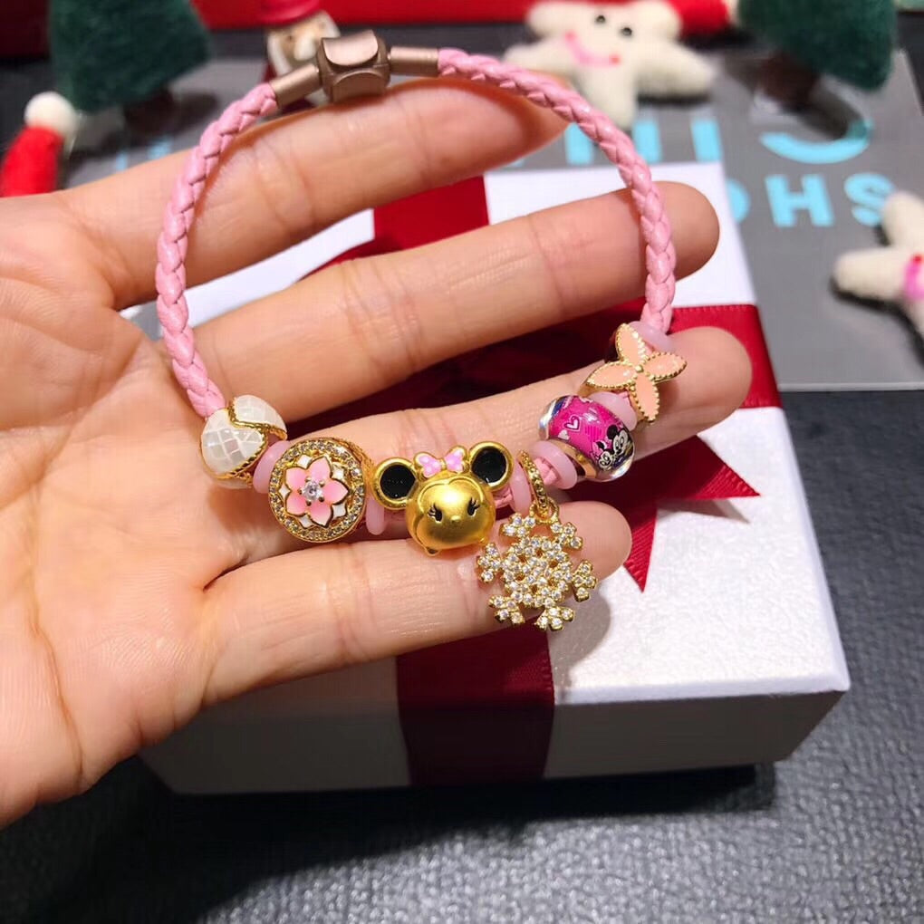Solid gold Disney Minnie pink leather charm bracelet