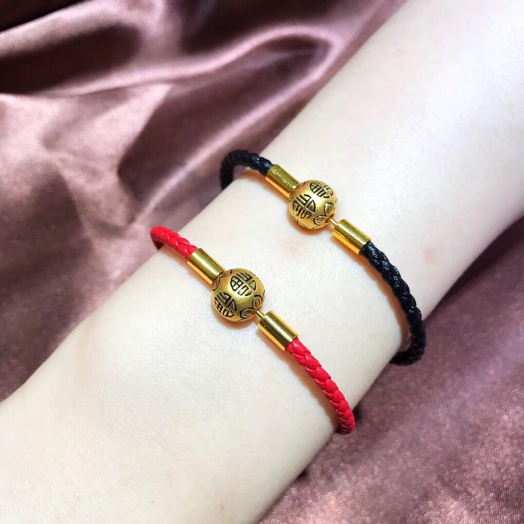 Solid gold chinese fu round clasp leather bracelet