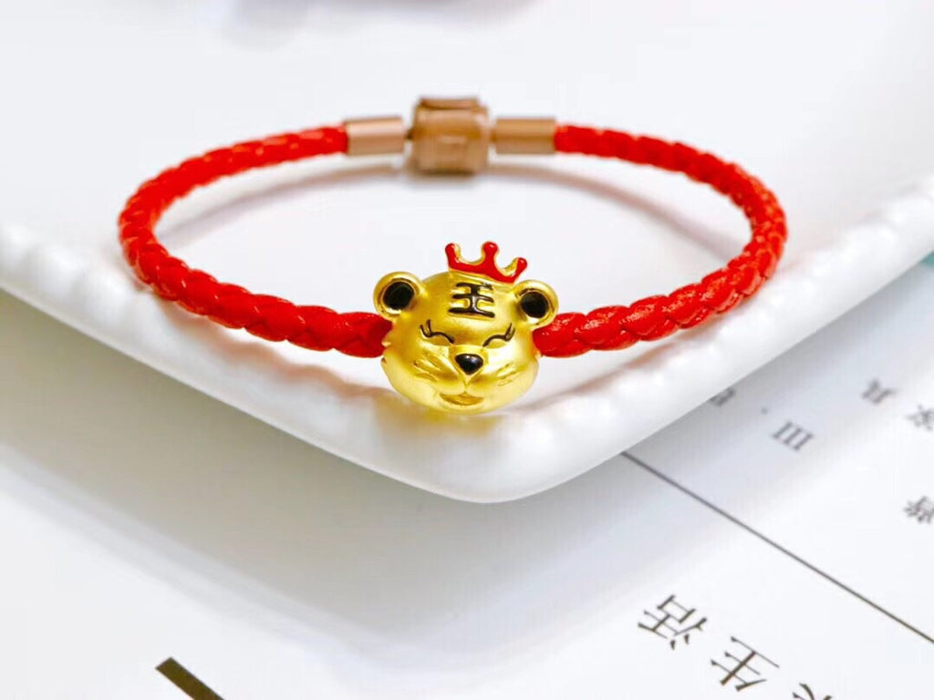 Gold tiger charm bracelet with red leather bracelet