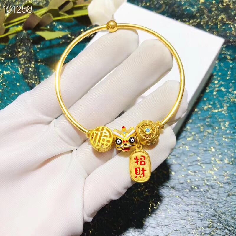 Gold charm bracelet with dancing lion wealth charm