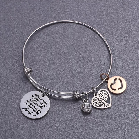 Push bangle bracelet with friends tree pendant
