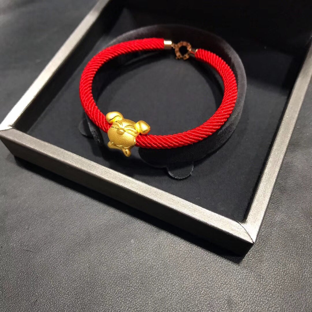 18k dog year dog charm with bvlgari red chain bracelet - Xingjewelry