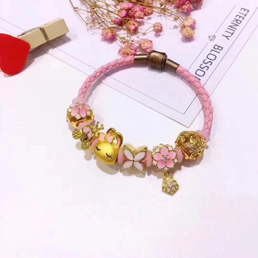leather bracelet with 24k hello kitty charm 6 pcs charm. - Xingjewelry