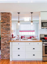 Feature pillar with reclaimed red brick in a kitchen - Oasis Outdoor Living