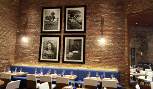 Wall above a booth in a restaurant with reclaimed brick - Oasis Outdoor Living