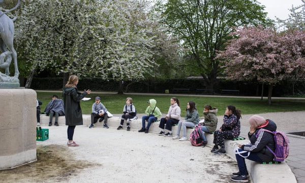 students learning outdoors in Denmark due to COVID