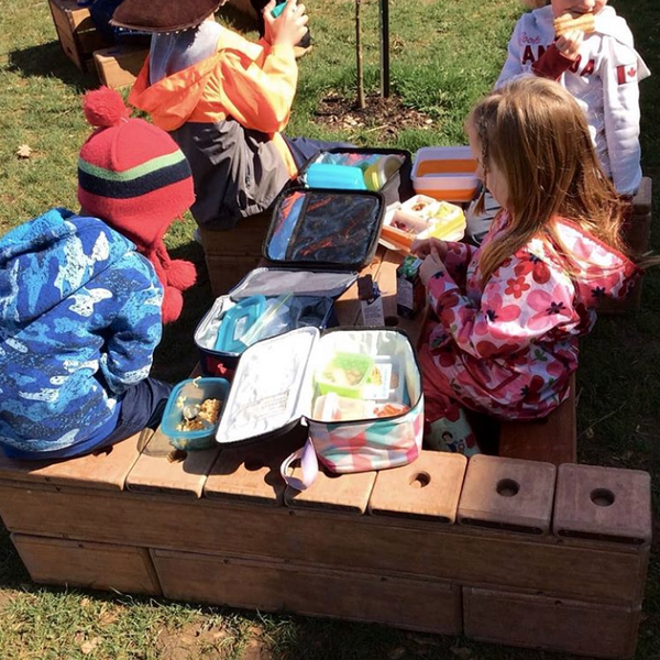 Picnic lunch with outlast blocks and elementary age childrent