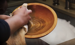 washing a wood bowl by hand
