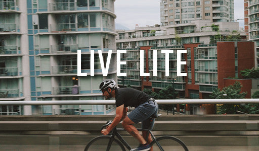 A man on a bike wearing Live Lite Shorts by DUER