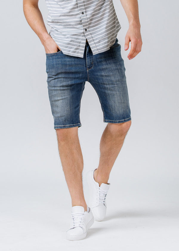 medium wash slim fit performance denim short front