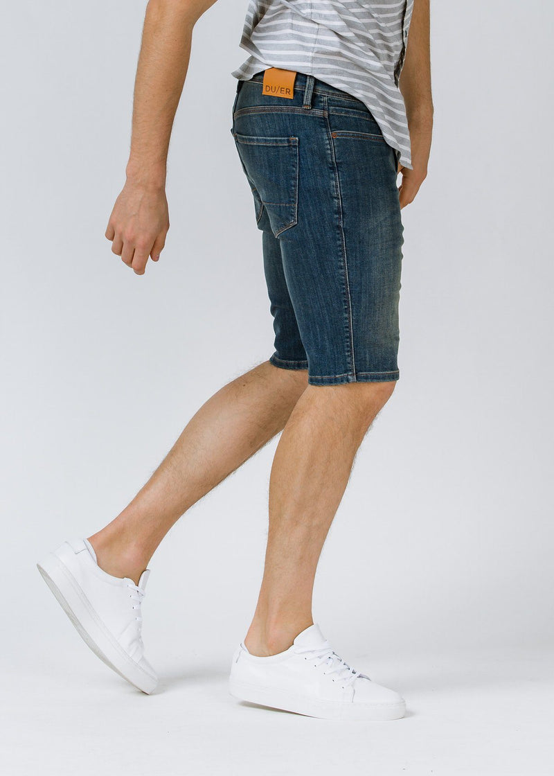 medium wash slim fit performance denim short side