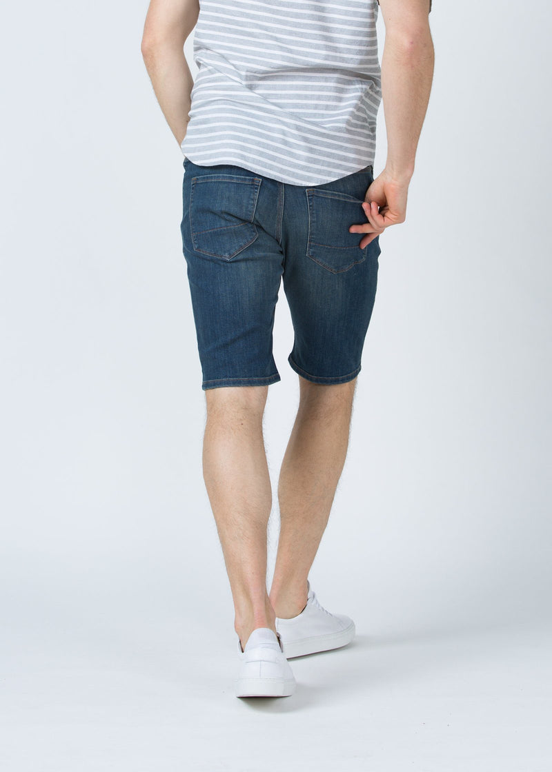 medium wash slim fit performance denim short back