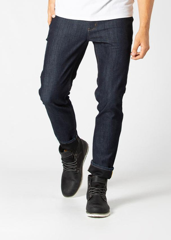 man wearing slim fit water resistant stretch jeans front