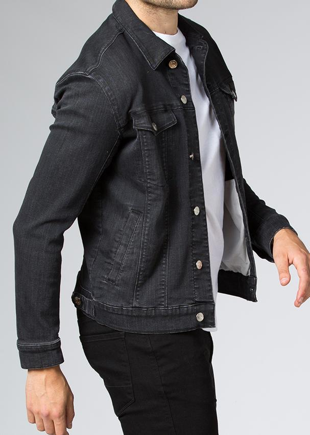 man wearing stretch denim jacket side