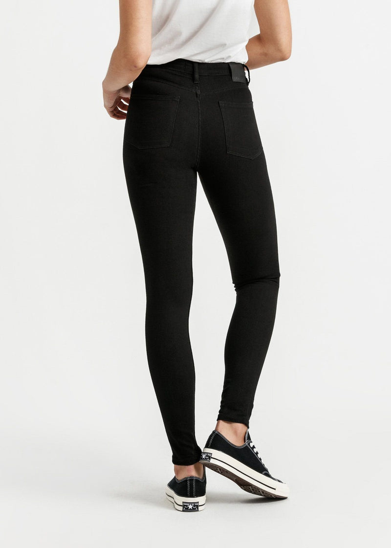 woman wearing high rise skinny fit black stretch jeans back