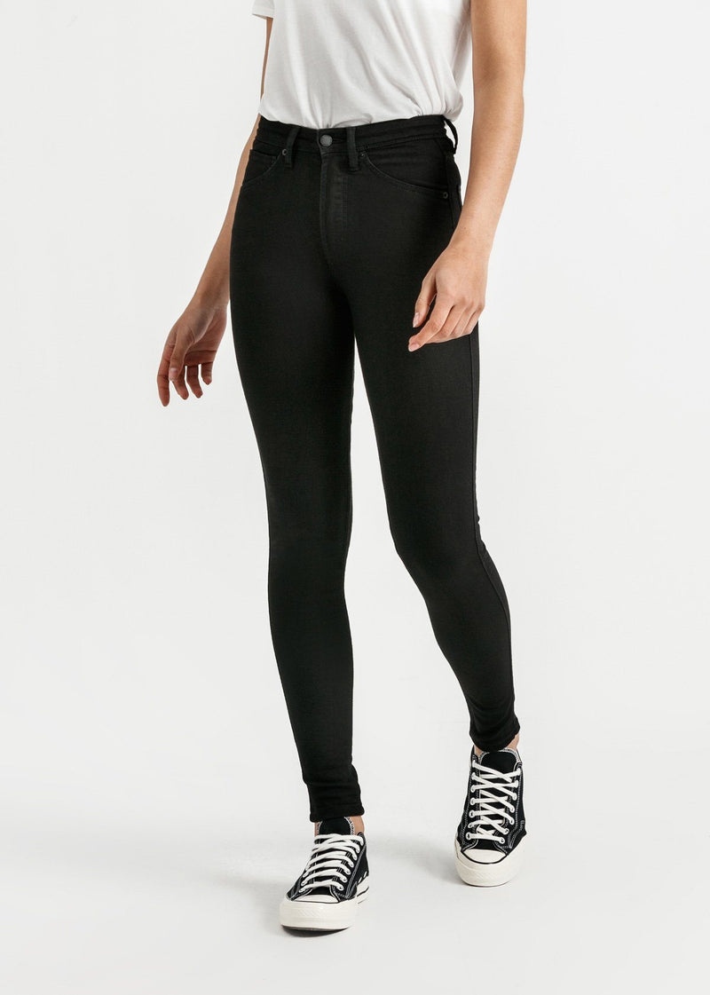 woman wearing high rise skinny fit black stretch jeans front