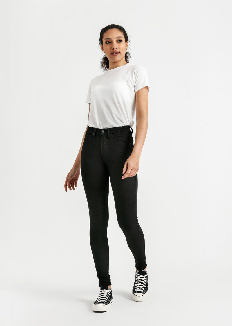 woman wearing high rise skinny fit black stretch jeans full body