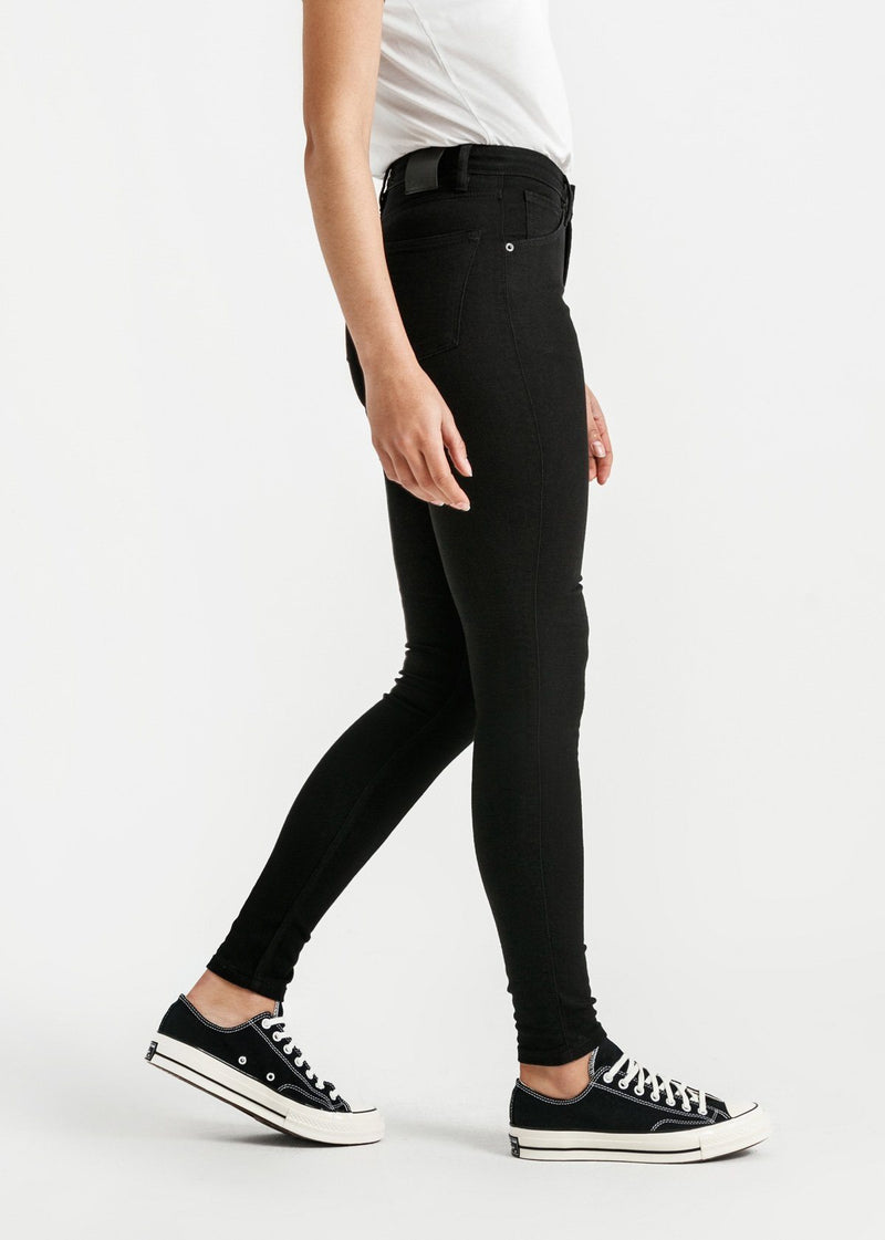 woman wearing high rise skinny fit black stretch jeans side
