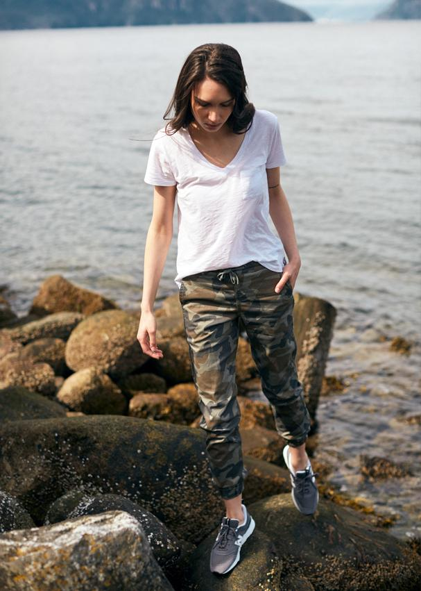 Woman near lake wearing camo athletic joggers
