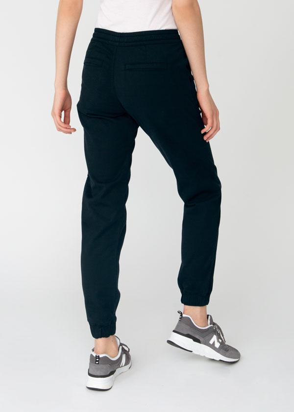 Woman wearing navy blue Athletic Jogger back