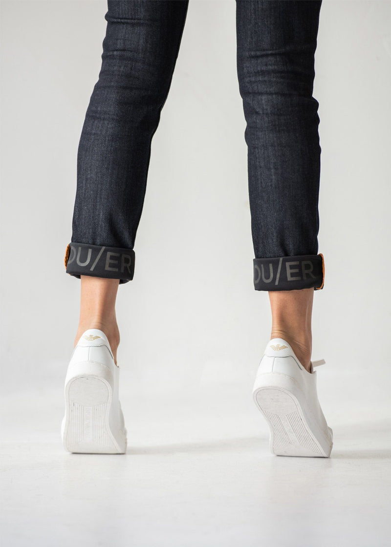 Women wearing all-weather waterproof jeans on tip toes