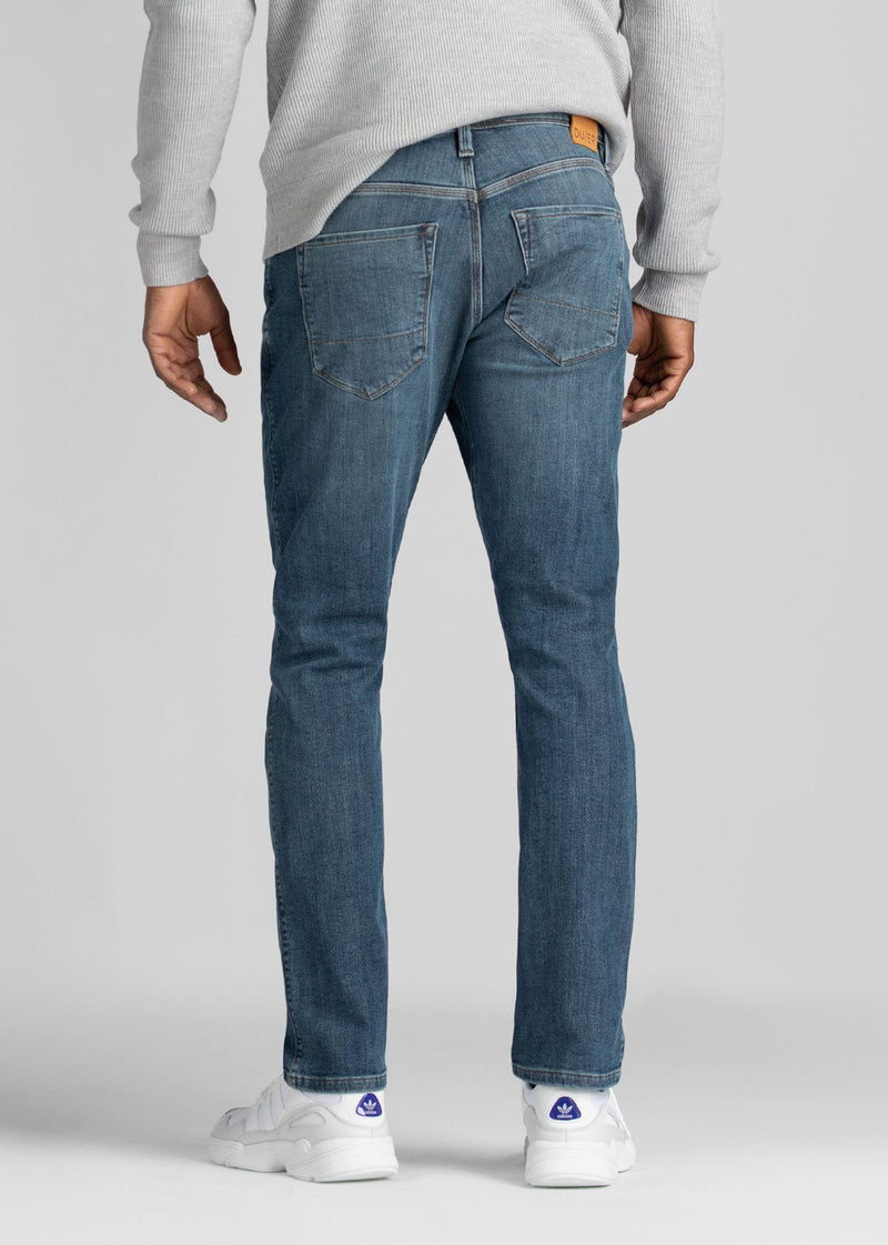 light wash relaxed fit warm stretch jeans back