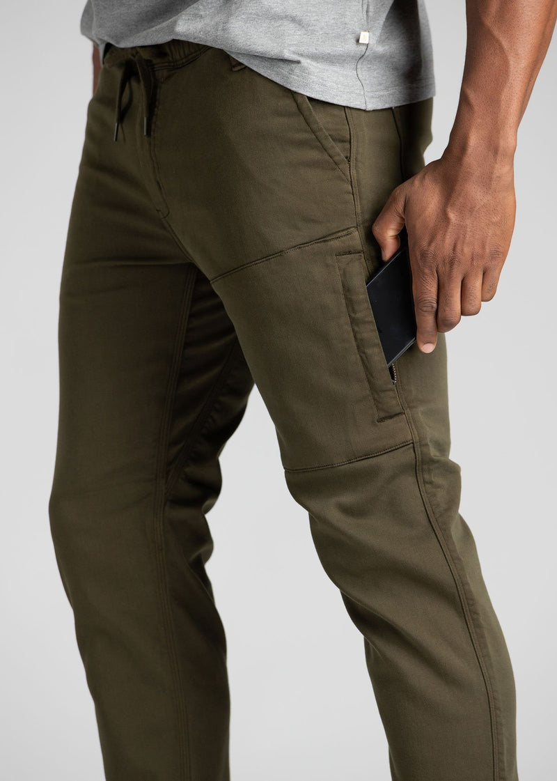 man wearing army green athletic joggers side detail