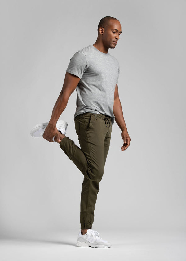 man wearing army green athletic joggers full body