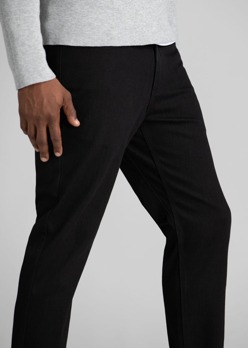 man wearing black slim fit waterproof stretch jeans side detail