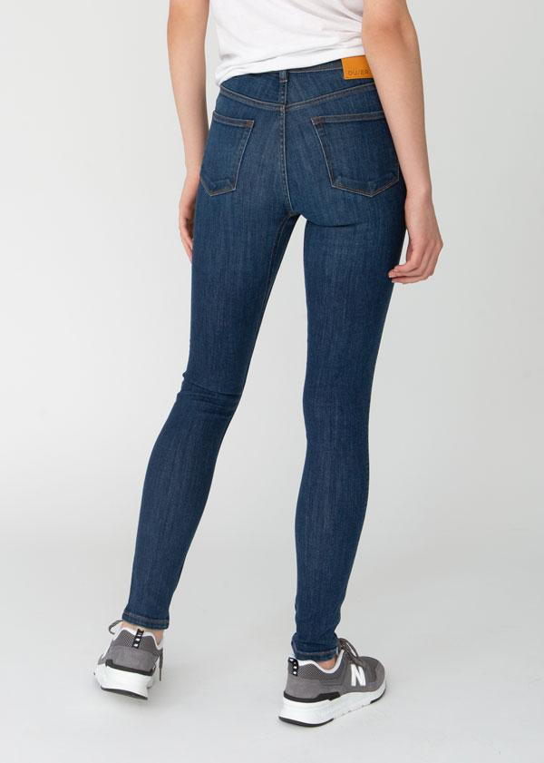 woman wearing high rise skinny fit blue stretch jeans back