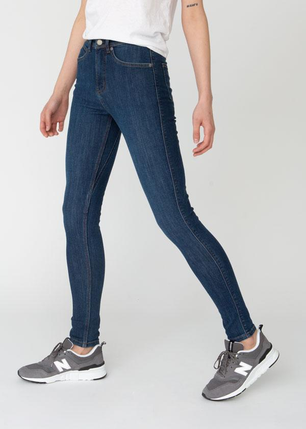 woman wearing high rise skinny fit blue stretch jeans side