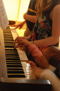 beautiful sounds...four sets of little hands on the piano