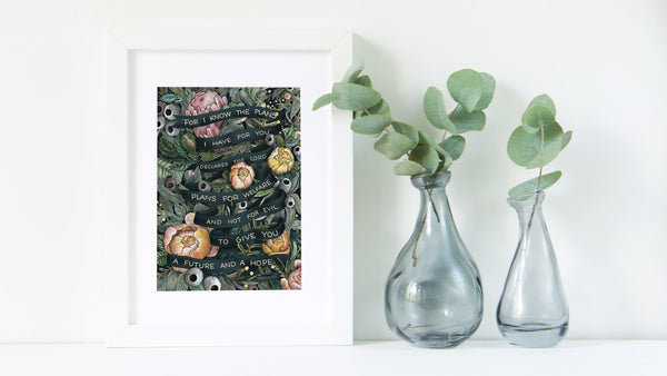 Photo of Jeremiah 29:11 artwork in a white frame styled with two vases with gumleaves