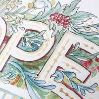 Close up of grape and leaf details surrounding the letters P and E of HOPE. Shows gold ink details.