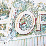 Close up of watercolour details surrounding the word HOPE