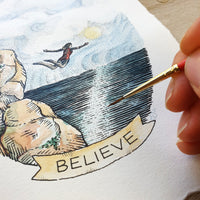"Close up of illustration showing details of water, the banner reading ""Believe"" and the artist's hand holding a red paintbrush"