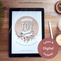 iPad sitting on wooden desk with front cover of Joy Journal loaded. Styled with apple pencil, candles, and fern leaf.