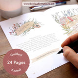 Joy Journal open to page 16 with hand holding pen poised to write in blank space. Candle and pencils in the background