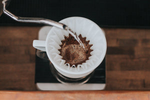 Craft or specialty coffee training, class in Chicago and Chicagoland. Making pour over coffee, Kalita Wave, pouring water over coffee grounds.
