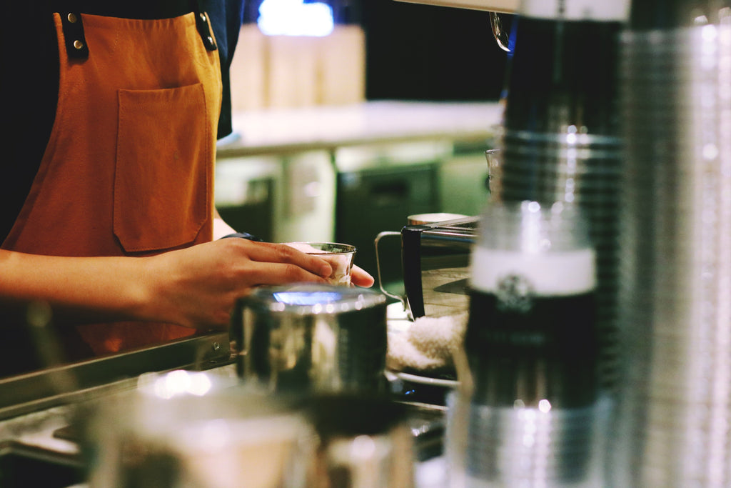 A barista preparing a craft coffee drink.