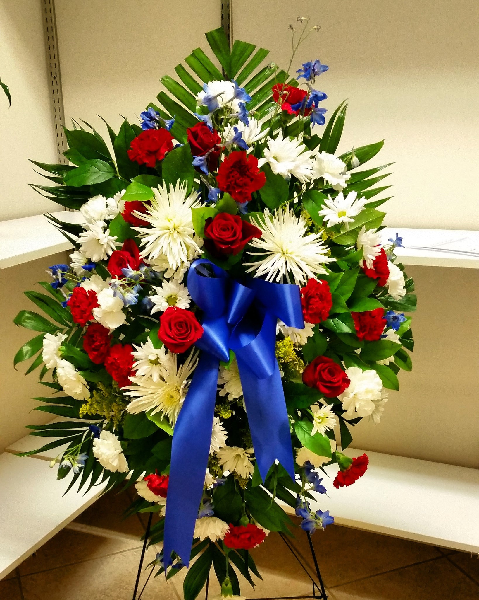 Standing spray military colors white red and blue flora funeral standing spray military colors white red and blue izmirmasajfo Image collections